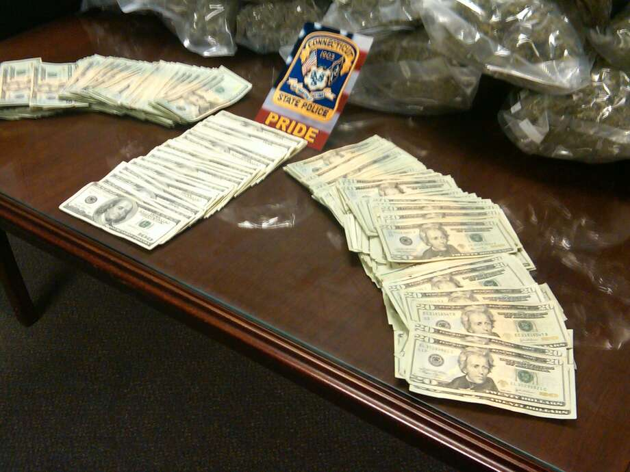 Evidence and money collected by State Police and displayed Thursday  (William Kaempffer/Register)