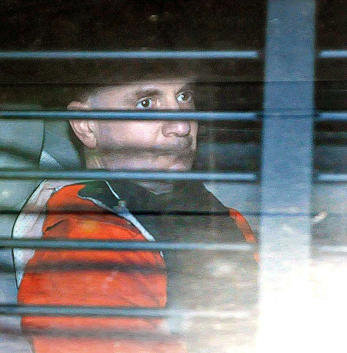 Steven Hayes looks out of the transport vehicle as he leaves court after being convicted on 16 out of 17 charges against him in the Cheshire home invasion murder trial. Photo/Peter Casolino ***