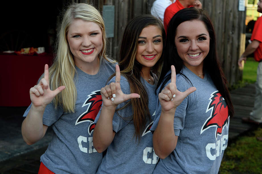 Cheerleaders Jalie Bell, Mallory Judice and Kayleigh Collie during Lamar University's football kickoff party at the Spindletop-Gladys City Museum on Thursday evening.  Photo taken Thursday 7/27/17 Ryan Pelham/The Enterprise Photo: Ryan Pelham, Ryan Pelham/The Enterprise / ©2017 The Beaumont Enterprise/Ryan Pelham