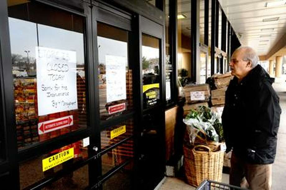 Joe Amarante is stopped short at the doors of the Branford Short Beach Big Y as he discovers the supermarket was closed for much of the day Monday due to a fire. VM Williams
