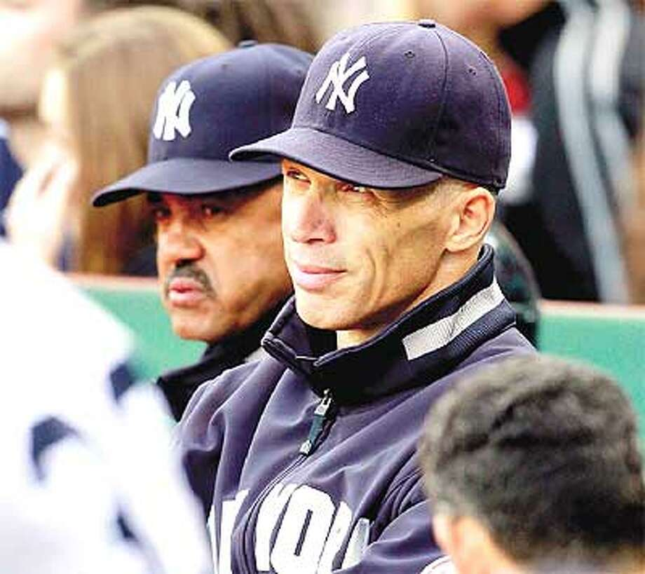 New York Yankees manager Joe Girardi, right, and bench coach Tony Pena look on in the ninth inning Sunday at Fenway Park. (Associated Press)