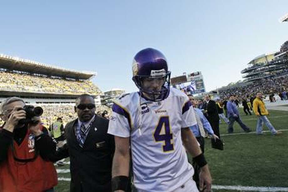 This Oct. 25, 2009 file photo shows Minnesota Vikings quarterback Brett Favre walking off Heinz Field after a 27-17 loss to the Pittsburgh Steelers. A person with knowledge of the situation tells The Associated Press that Brett Favre has informed the Vikings he will not return to Minnesota for a second season. The person spoke on condition of anonymity Tuesday because the team had not made an official announcement. (Associated Press/Gene J. Puskar) Photo: AP / AP