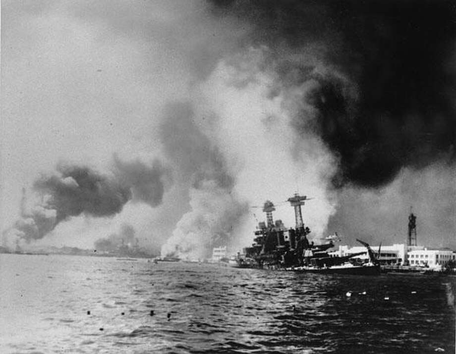 This Dec. 7, 1941 file photo provided by the Dept. of Defense shows the USS California, right,  after being struck by two battleships and two big bombs during a Japanese sneak attack on Pearl Harbor.  (AP Photo/DOD) Photo: AP / DOD