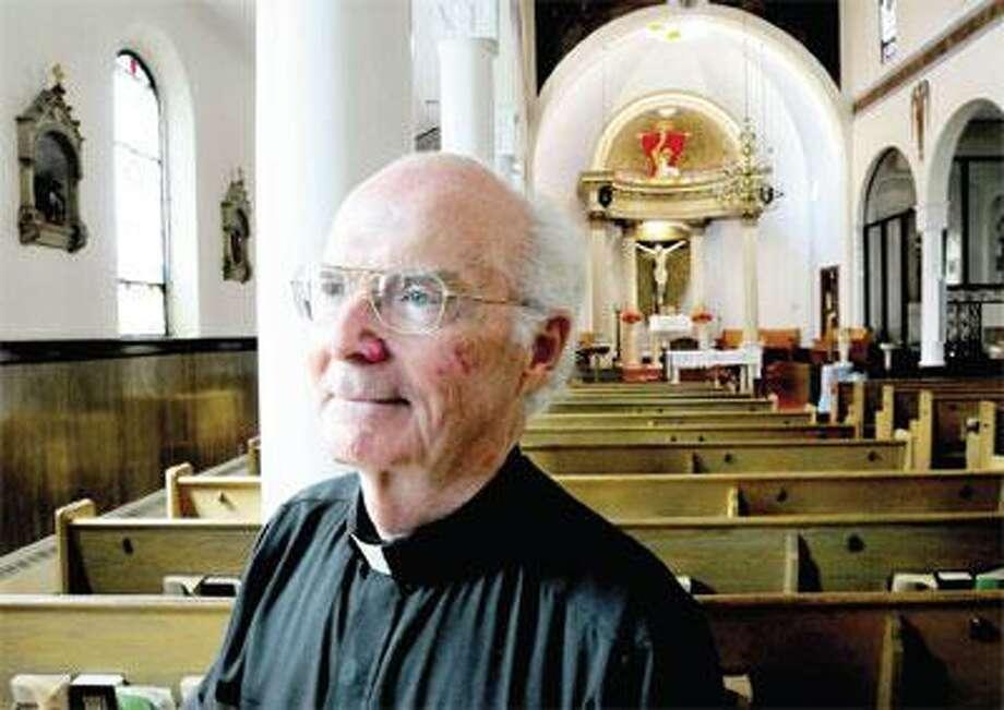 The Rev. John J. Keane has led the St. Ann's Church parish since 2004. (Arnold Gold/Register)