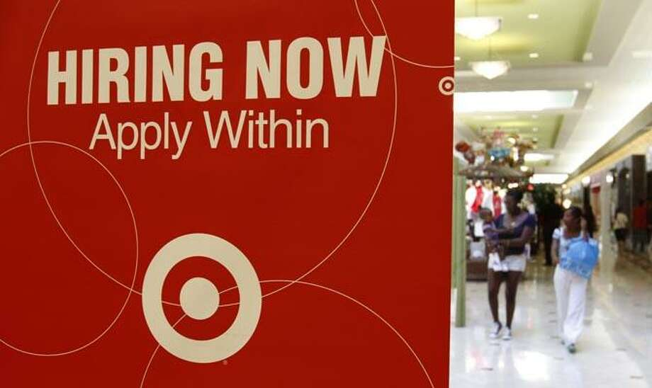On this Sept. 29, 2010 photo, a Target store advertises for employment, in Daly City, Calif. Retailers including Toys R Us, Pier 1 and Borders plan to hire more temporary holiday workers this season than last year, emboldened by several months of sales gains and a slowly improving economy. While such jobs will be an early Christmas present for some of America's unemployed, they're unlikely to make a dent in the stubbornly high unemployment rate. (AP Photo/Ben Margot) Photo: AP / AP