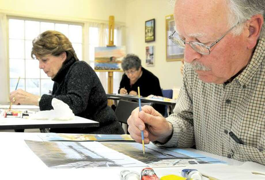 "Joan Young, left, Rae Maselli and Julian Erde are taking the ""How to Draw Straight Lines"" course at the New Artists' View Learning Center in Madison. (Brad Horrigan/New Haven Register)"