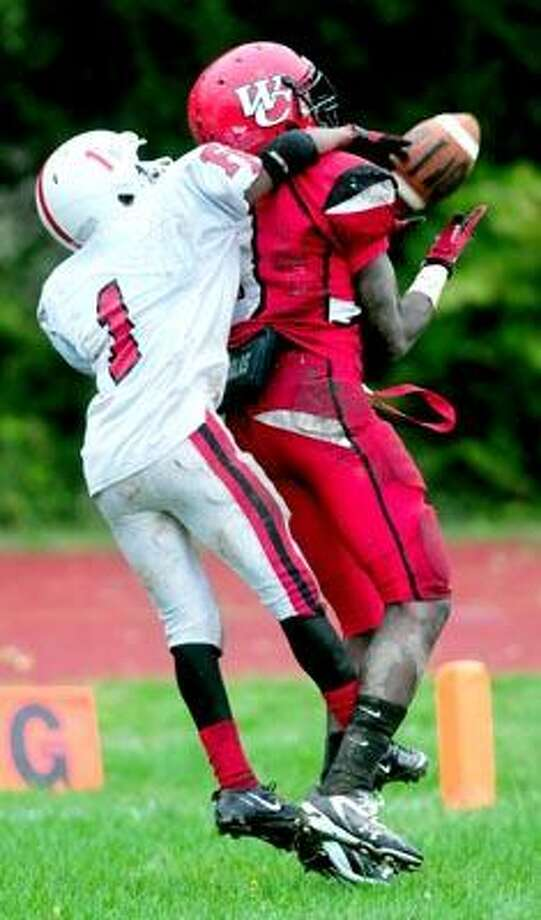 Myles Gaines (left) of Fairfield Prep is called for pass interference defending on a pass play to Gerald McClease (right) of Wilbur Cross in the first half on 10/1/2010.Photo by Arnold Gold   AG0386D