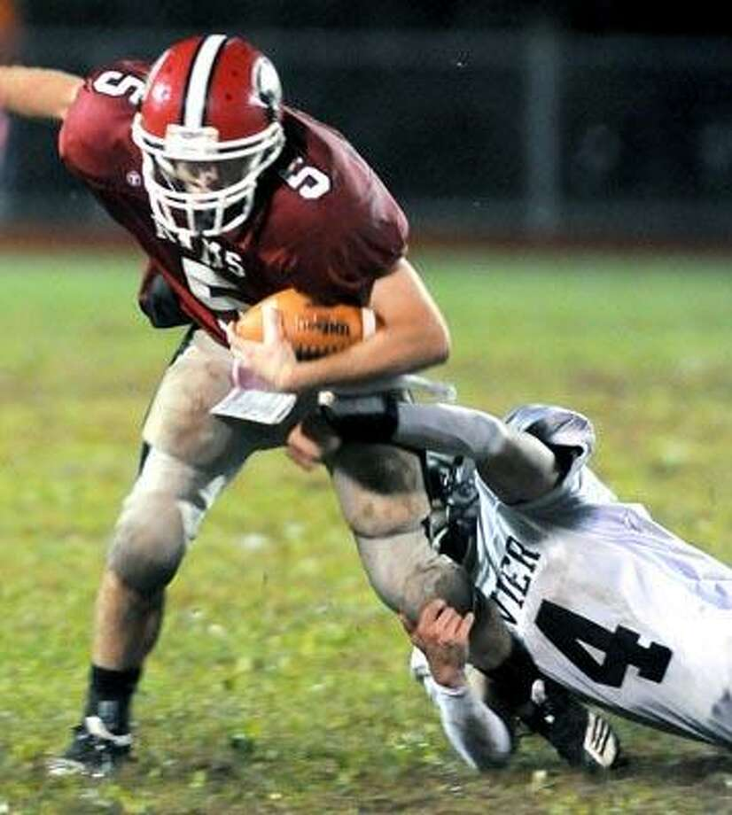 Cheshire quarterback Max Slade (left) is tackled by Ryan Jacobucci (right) of Xavier in the first half at Cheshire on 10/1/2010.Photo by Arnold Gold  AG0386D