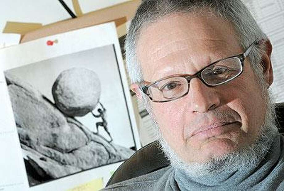 New Haven Chief Public Defender Thomas Ullmann, with an image of the Myth of Sisyphus. (Brad Horrigan/Register)