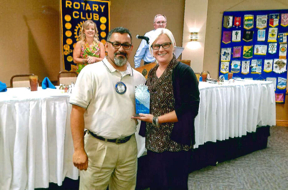 Rotarian Robert Riojas presented Melinda Brown with the Rotarian of the Quarter award during a recent club meeting