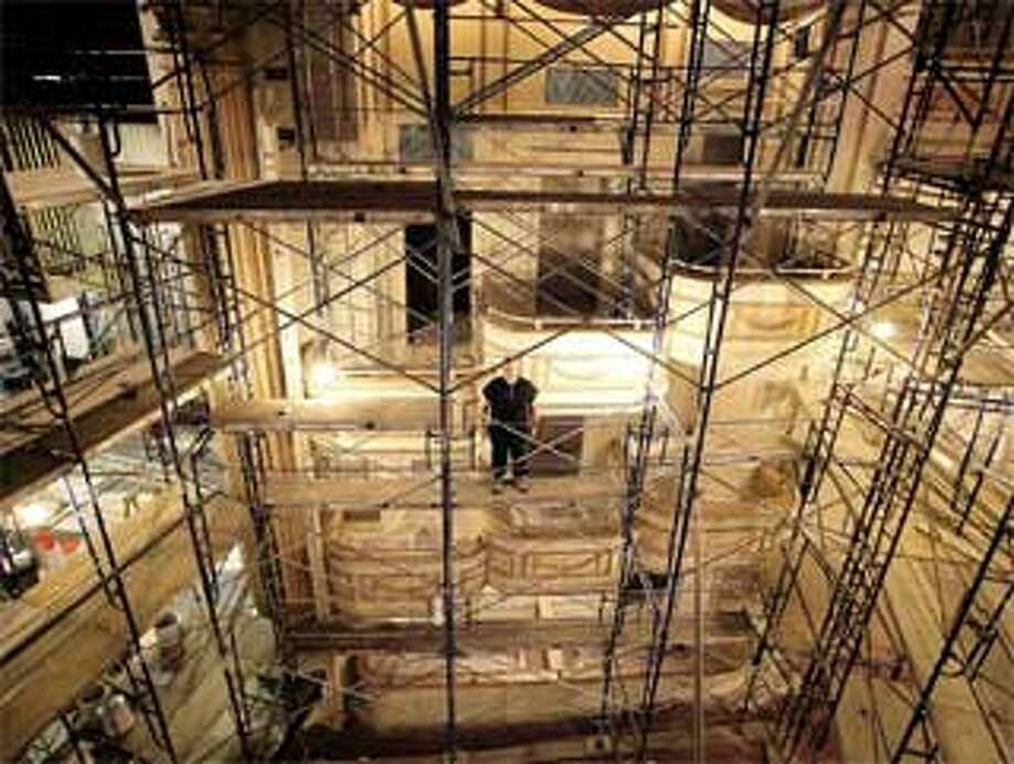 Shubert production carpenter Ed Mangini stands amid the five stories of scaffolding assembled to reach the heights of the restoration effort. Cheshire's John Canning & Co., Ltd. was the main contractor of the six-week project. (Peter Casolino/Register)