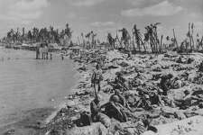 US marines huddled on the beaches during the Battle of Tarawa in World War Two, Kiribati, November 1943. (Photo by US Marine Corps/Getty Images)