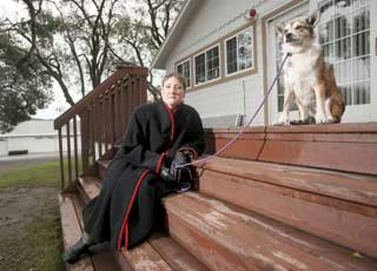 Sharon Pederson at a friend's house in Petaluma, Calif., with Kellen, her Norwegian lundehund. Pederson is a study subject who got deep brain stimulation, or DBS, surgery for her Parkinson's disease. (AP Photo)