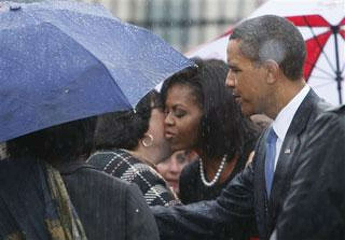 President Barack Obama and first lady Michelle Obama greet family members of victims of the Pentagon attack, Friday, Sept. 11, 2009, at the Pentagon, during a ceremony marking the eighth anniversary of the Sept. 11 attacks. (AP Photo/Charles Dharapak)