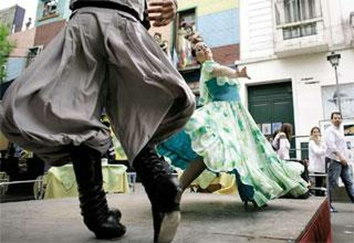 Dancers perform traditional Argentine dances in the La Boca neighborhood of Buenos Aires. (AP Photos)