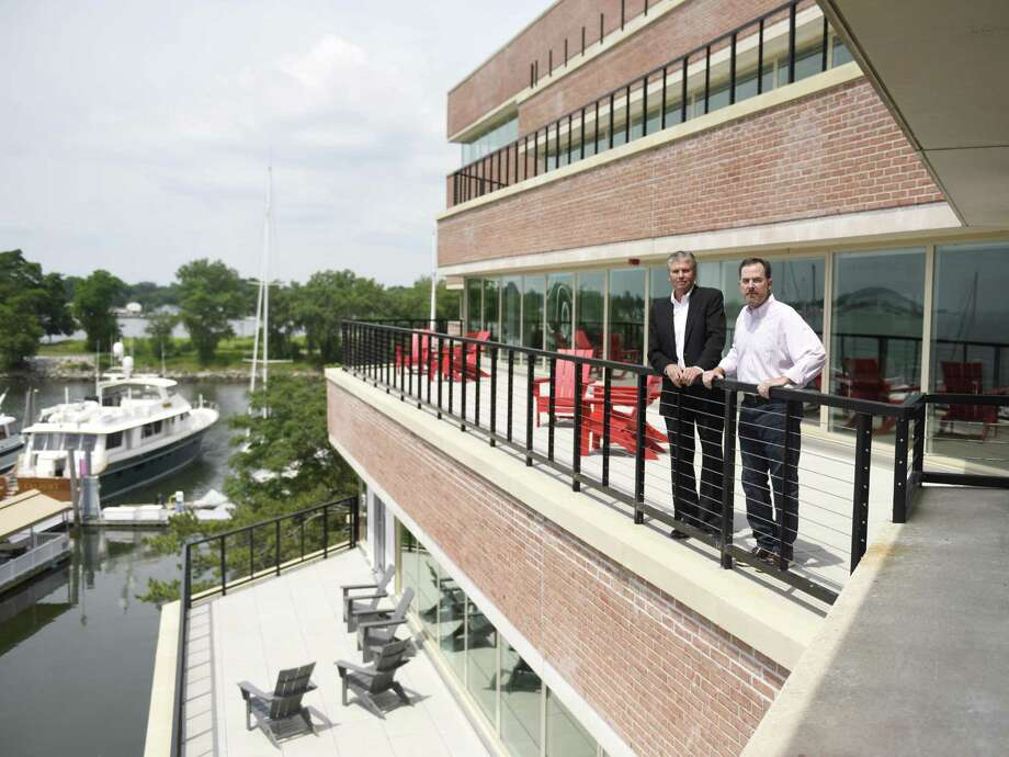 Octagon Chairman and CEO Rick Dudley, left, and Octagon President of Marketing and Events John Shea pose at the new Octagon Sports & Entertainment Agency headquarters at the Shippan Landing office park in Stamford, Conn. Tuesday, July 11, 2017. After more than a decade in Norwalk, Octagon just opened its new space on the third floor of 290 Harbor Drive, offering panoramic views of the harbor to inspire creativity. Photo: Tyler Sizemore / Hearst Connecticut Media / Greenwich Time