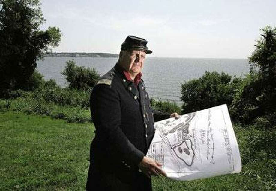 Peter Casolino/Register William MacMullen, president of Fort Nathan Hale Projects Inc., holds battle plans for the 1861 Battle of Port Royal re-enactment. The naval bombardment and amphibious landing of troops is scheduled for 2 p.m. Saturday.