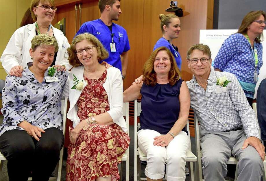 Robin Gilmartin of West Hartford, left, who donated her kidney to Patricia Villers of Ansonia, , and Suzanne Watson of Laconia, New Hampshire, sister-in-law to Villers who shared her kidney with William Greenwood of Bethel, left to right, during a press conference Thursday afternoon announcing a unique and successful 18-patient, 9-kidney chain kidney transplant exchange at Yale New Haven Hospital by the Yale New Haven Transplantation Center (YNHTC) that took place over two months starting on May 9, 2017. The YNHTC kidney transplant exchange was one of the largest kidney chain exchanges for one center ever in the United States, matching nine donors for nine recipients in a series of connected and successful surgical procedures. Of the 18 patients, 14 are from Connecticut, with two from New York and one each from New Hampshire and Florida. Photo: Peter Hvizdak / Hearst Connecticut Media / New Haven Register