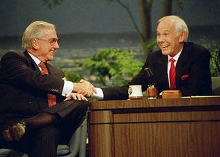 """In this May 22, 1992 file photo, Ed McMahon, left, shakes hands with talk show host Johnny Carson, during the final taping of the """"Tonight Show"""" in Burbank, Calif. McMahon has died at a Los Angeles hospital, according to his publicist. He was 86. (AP Photo/Douglas C. Pizac, File)"""