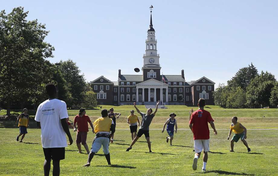 Campers at Project Common Bond play football at Colby College in Waterville, Maine. The camp brings together an international group of teenagers who have been affected by terrorism. Photo: Robert F. Bukaty, Associated Press