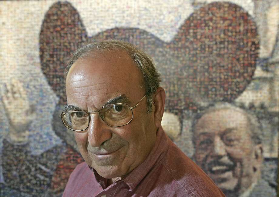 FILE - In this July 11, 2005 file photo, Martin �Marty� Sklar, Imagineering Vice Chairman and Principal Creative Executive, poses in front of a picture of Mickey Mouse and Walt Disney at Disneyland in Anaheim, Calif. Sklar, one of the central figures behind Disney�s theme parks around the world, has died.  Sklar had a role in the opening of every Disney park, starting with the original Disneyland in 1955. A Disney statement said he died Thursday, July 27, 2017, at his Hollywood Hills home at age 83.  (AP Photo/Jae C. Hong, File) Photo: Jae C Hong, Associated Press