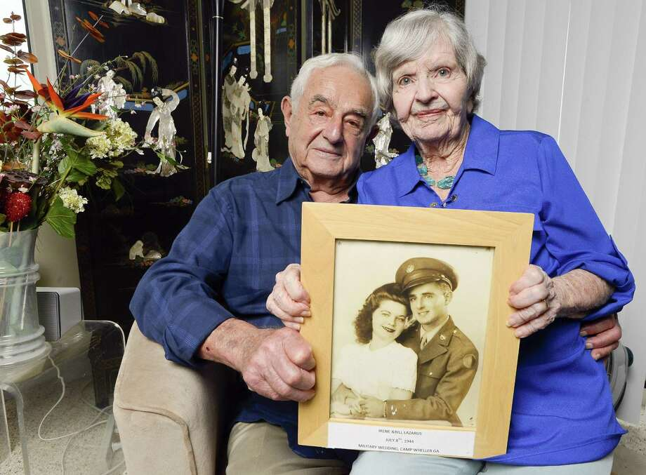 Bill and Irene Lazarus are photograph on Thursday, July 27, 2017 with theirJuly 8th, 1944 wedding photograph in their Stamford, Connecticut home. The couple is celebrating 73 years of marriage together. Photo: Matthew Brown / Hearst Connecticut Media / Stamford Advocate