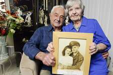 Bill and Irene Lazarus are photograph on Thursday, July 27, 2017 with theirJuly 8th, 1944 wedding photograph in their Stamford, Connecticut home. The couple is celebrating 73 years of marriage together.
