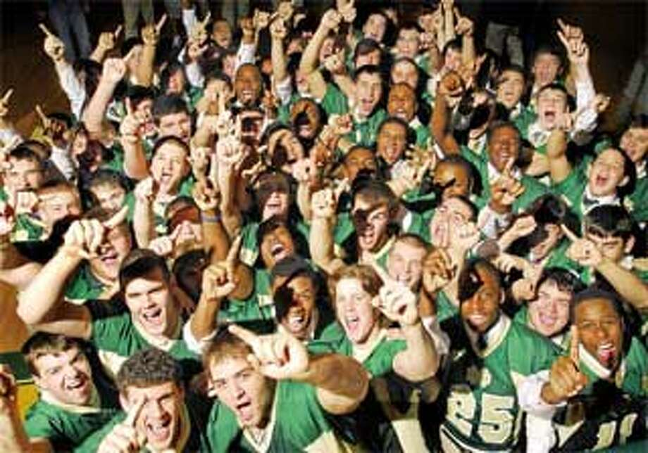 The Green Knights of Notre Dame High School in West Haven celebrate their selection Monday as the No. 1 team in the New Haven Register's final Top 10 poll. Notre Dame catapulted to the top spot after defeating No. 2 Pomperaug 28-21 for the Class L title Saturday, and former No. 1 Staples lost to Cheshire 28-21 in overtime Sunday. Notre Dame also climbed over New London and Xavier, which lost in the playoff semifinals. The Green Knights finished their championship season at 11-1. (Peter Hvizdak/Register)