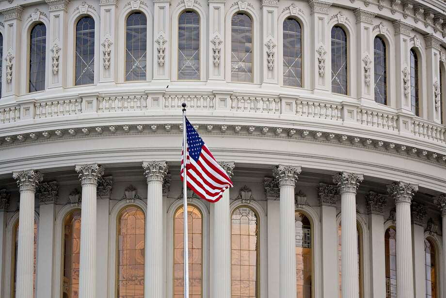 The American flag flies outside the U.S. Capitol in Washington, D.C., on Friday. Photo: Andrew Harrer, Bloomberg