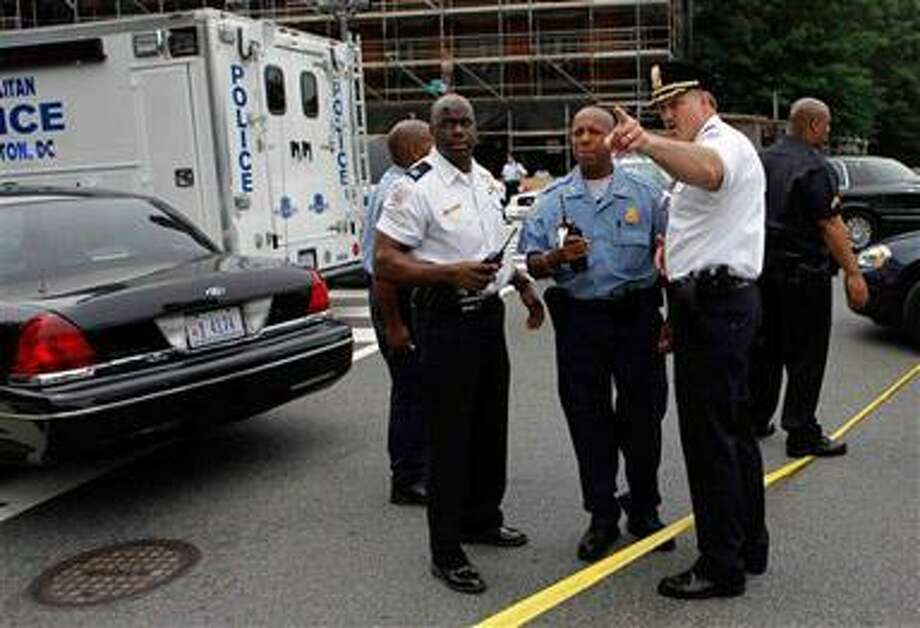 Police are seen outside the U.S. Holocaust Memorial Museum in Washington, Wednesday, June 10, 2009. Authorities say at least two people have been shot at the museum. (AP Photo/Gerald Herbert)