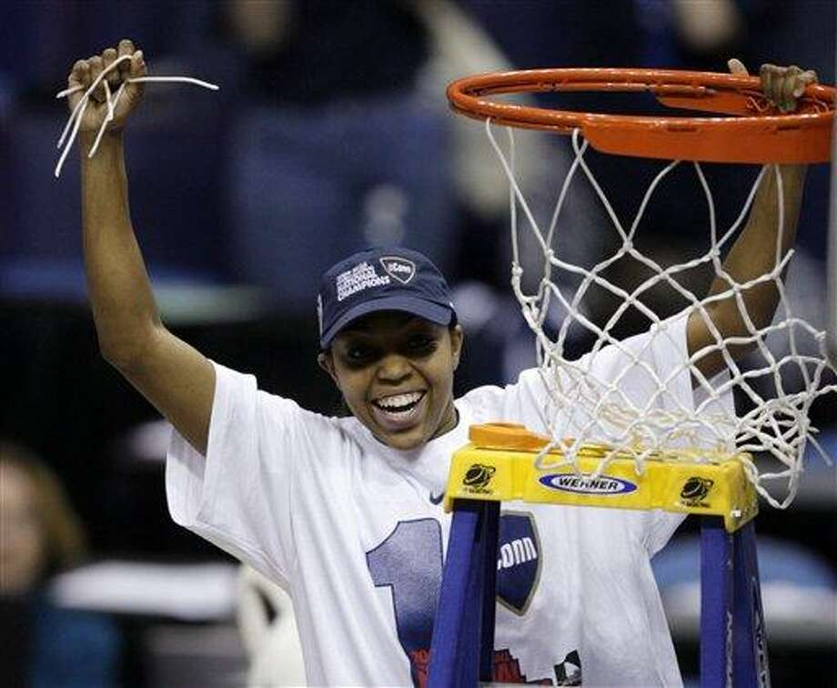 Connecticut's Renee Montgomery celebrates after cutting the net following Connecticut's 76-54 win over Louisville in the championship game at the women's NCAA college basketball tournament Final Four on Tuesday, April 7, 2009, in St. Louis. (AP Photo/Jeff Roberson) Photo: AP / AP