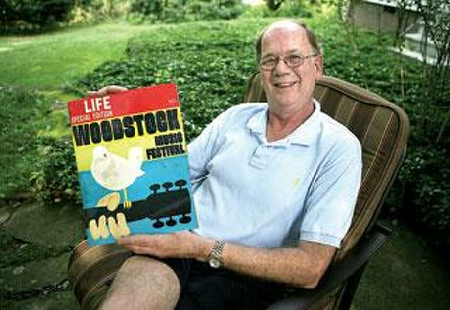 Steve Abeling of Woodbridge, who was at Woodstock, shows off Life magazine's commemorative issue. 9Peter Casolino/Register)