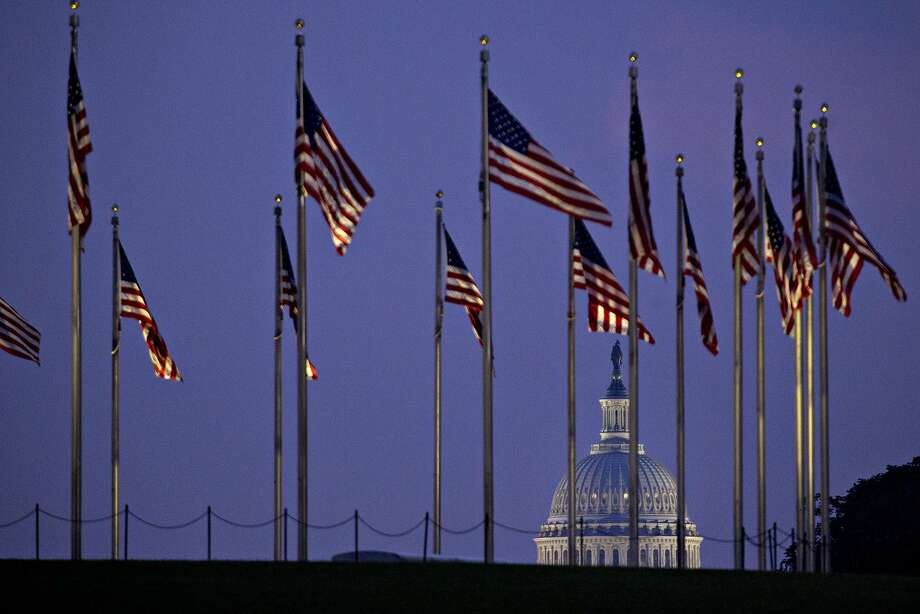 American Flags stand in front of the U.S. Capitol before sunrise in Washington, D.C., on Friday. Photo: Andrew Harrer, Bloomberg