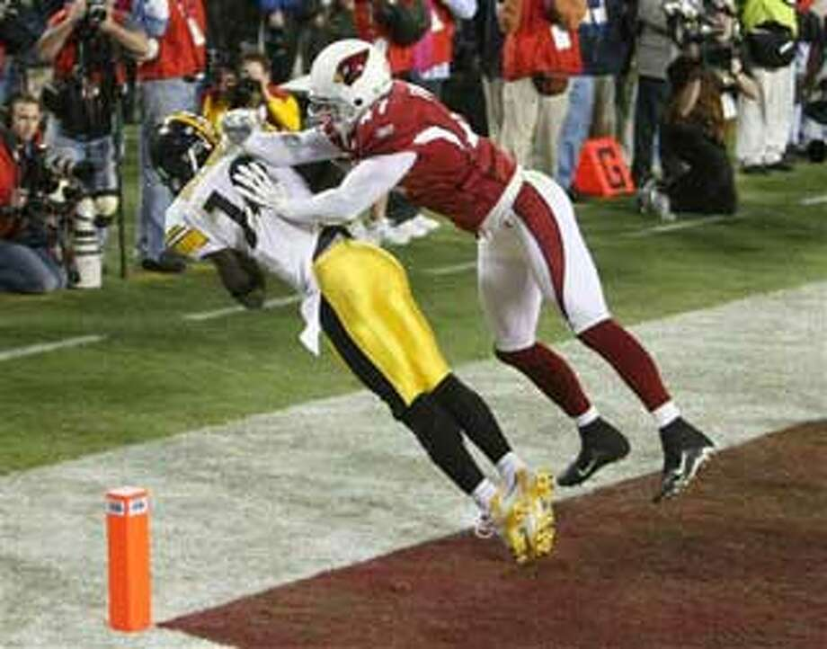 Pittsburgh Steelers wide receiver Santonio Holmes (10) catches a touchdown pass as Arizona Cardinals safety Aaron Francisco (47) defends during the fourth quarter of the NFL Super Bowl XLIII football game, Sunday, Feb. 1, 2009, in Tampa, Fla. (AP Photo/St. Petersburg Times, James Borchuck)