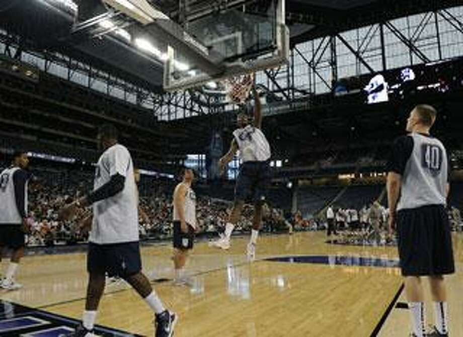 University of Connecticut basketball player Hasheem Thabeet dunks the ball during team practice.  Photo taken on Friday, April 3, 2009, at Ford Field in Detroit, Mich.  (The Oakland Press/Jose Juarez)