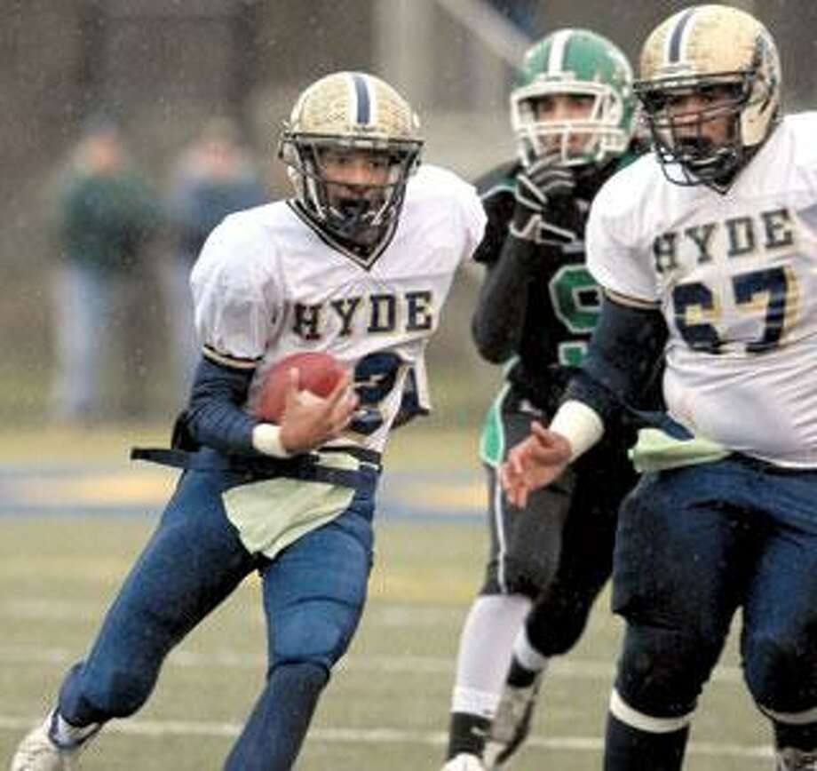 Hyde's QB Kendall Groom, left, carries and #67 Christopher Pardy right blocks. (Mara Lavitt/Register)