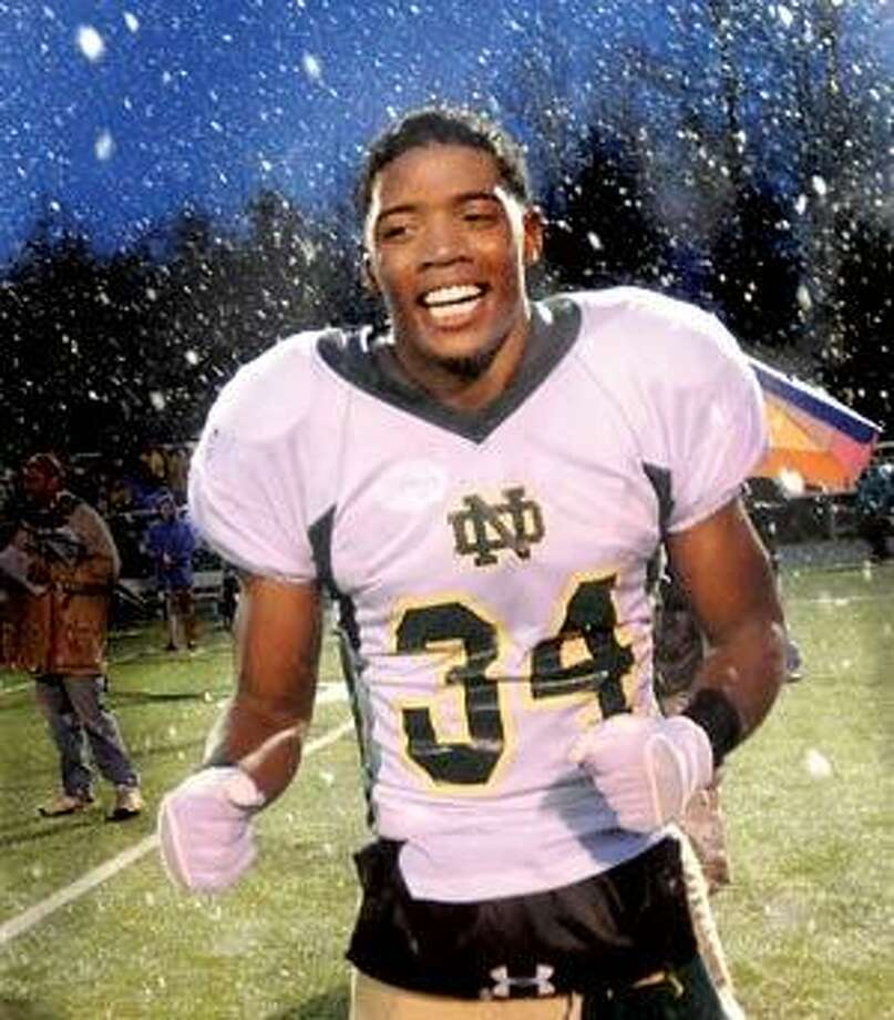 Notre Dame's Justin Willis is all smiles as he takes to the field after winning the Class L Championship game (Melanie Stengel/Register)