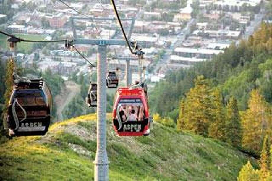 The Silver Queen Gondola is seen above downtown Aspen.
