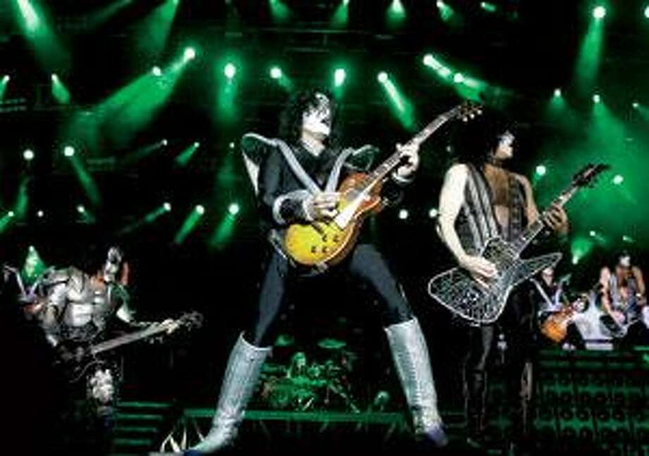 Gene Simmons, left, and Paul Stanley, second from right, formed Kiss more than three decades ago. The band put the makeup back on and reunited the original lineup about a decade ago. Nowadays, Kiss is just Simmons and Stanley and a couple of hired guns. See them all at Mohegan Sun Arena Saturday. (Associated Press)