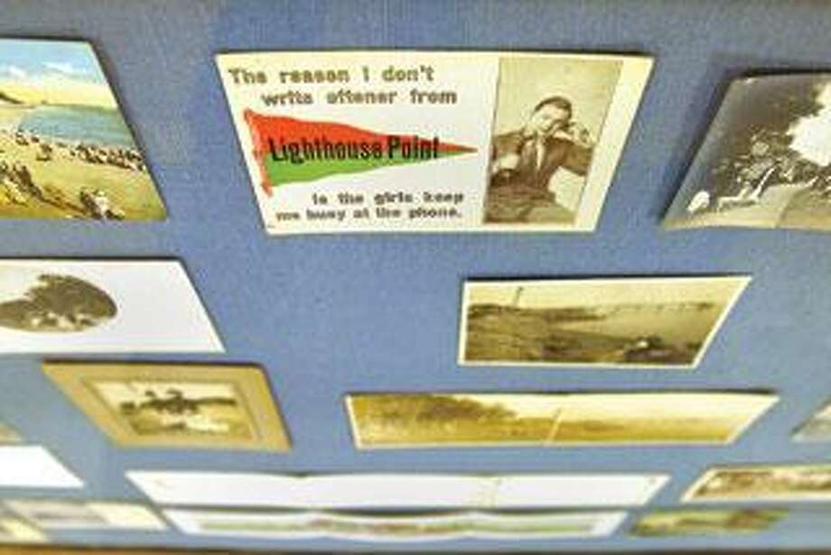 """A collection of postcards is part of """"East Shore Reflections."""" (Brad Horrigan/Register)"""