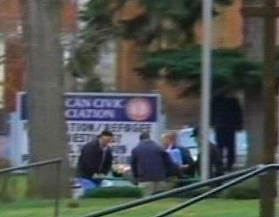 In this photo rendered from video and released by WBNG-TV in Binghamton, N.Y., authorities remove a person on a stretcher, Friday, April 3, 2009, in Binghamton, N.Y. At least four people were shot and as many as 41 people taken hostage Friday morning at an immigration services center in western New York state, according to media reports. (AP Photo/WBNG-TV)