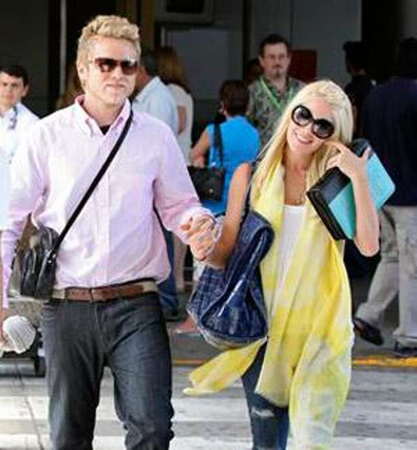 """In this image released by NBC on Friday, May 29, 2009 and taken on May 27, Spencer Pratt and Heidi Montag leave the airport after arriving in San Jose, Costa Rica for the NBC reality show, """"I'm a Celebrity, Get Me Out of Here,"""" which premiered Monday, June 1. (AP Photo/NBC, Tyler Golden)"""