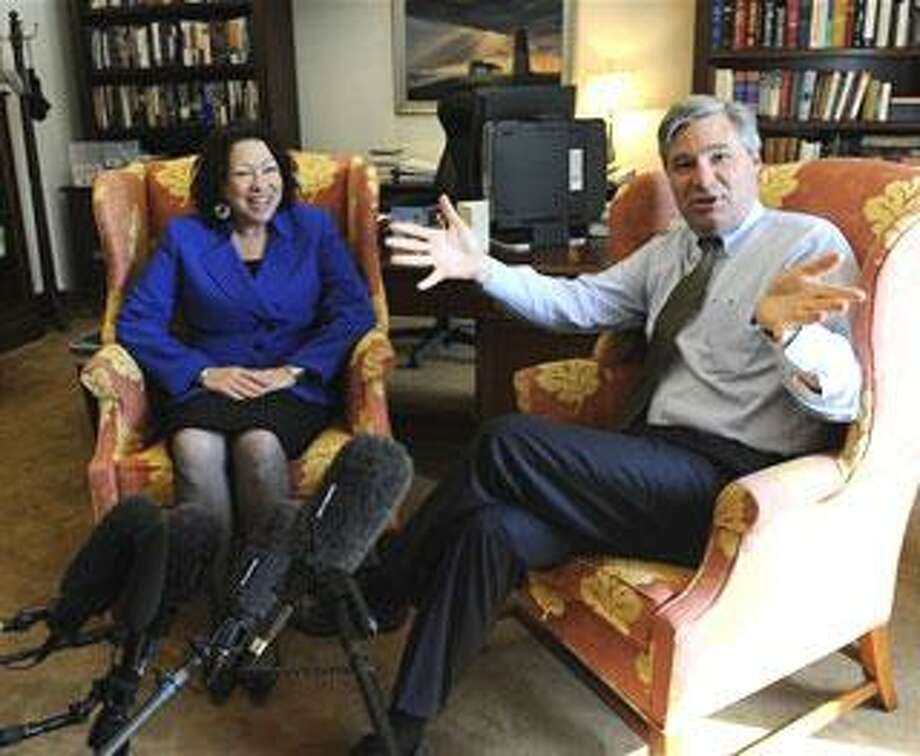 Supreme Court nominee Sonia Sotomayor meets with Sen. Sheldon Whitehouse, D-R.I., in his office on Capitol Hill in Washington, Wednesday, June 3, 2009. (AP Photo/Susan Walsh)