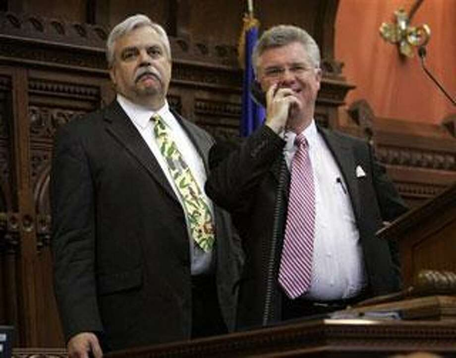 Connecticut Speaker of the House Rep. Christopher Donovan, D-Meriden right, speaks on the telephone as Deputy Speaker Rep. Robert Godfrey, D-Danbury, left, listens during a session of the House at the state Capitol in Hartford, Conn., Monday, June 1, 2009. Both houses of the Connecticut General Assembly face a mandatory Wednesday, June 3, 2009 adjournment date, but have already voted to go into special session after the regular session is over. (AP Photo/Bob Child)
