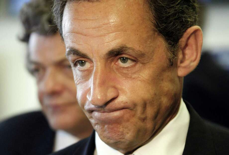 French President Nicolas Sarkozy, right, with at his side Minister in charge of Transports Jean-Louis Borloo, left, addresses reporters at a crisis meeting  at Paris Charles de Gaulle airport Monday June 1, 2009. An Air France jet with 228 people on board dropped off radar over the Atlantic ocean off the Brazilian coast. Air traffic control lost contact with the flight after it took off from Rio de Janeiro. (AP Photo/Guillaume Baptiste, Pool) Photo: AP / POOL AFP