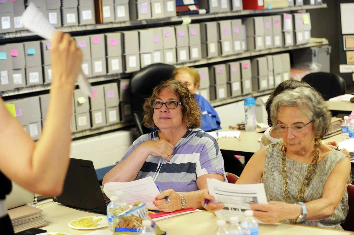 Sandy Golove (left), of Stamford, and Elaine Marks, of Greenwich, listen to Janeen Bjork lead a genealogical workshop at the Jewish Historical Society of Fairfield County on Hope Street in Stamford, Conn. on Wednesday, July 26, 2017.