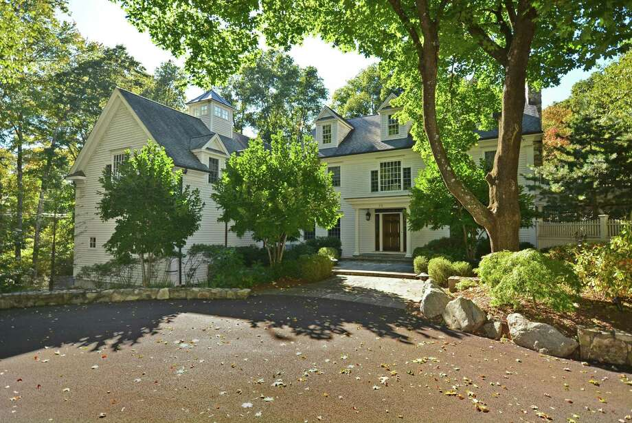 The custom colonial house at 95 Indian Waters Drive has 8,564 square feet of living and entertaining space, which continues onto its 2.59-acre property. Photo: Contributed Photos
