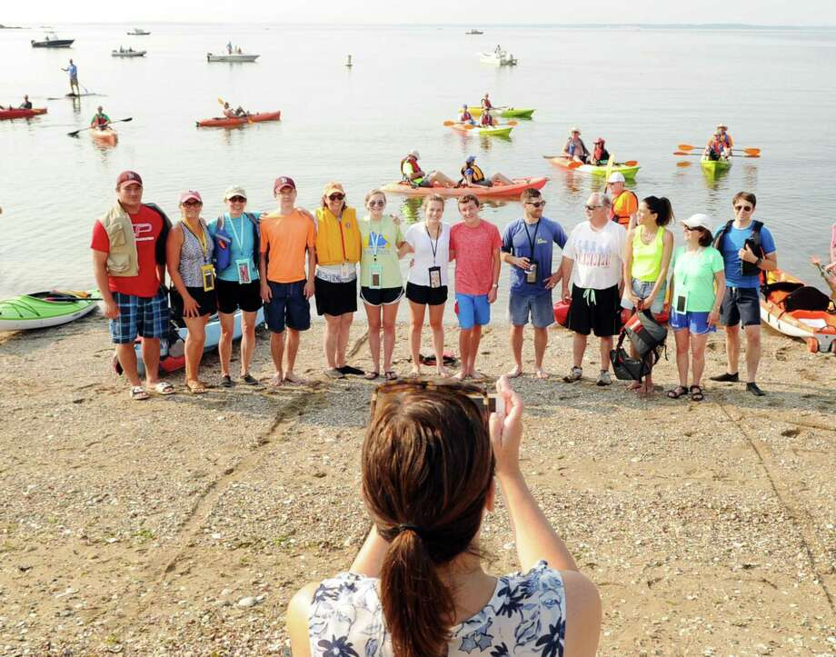 The Holly Pond Paddlers of Darien have a group photo taken during the SoundWaters Flotilla Fundraising Event to protect Long Island Sound, a kayak and paddle board event that started from Cove Island Park in Stamford Saturday morning, July 22. Photo: Bob Luckey Jr. / Hearst Connecticut Media / Greenwich Time