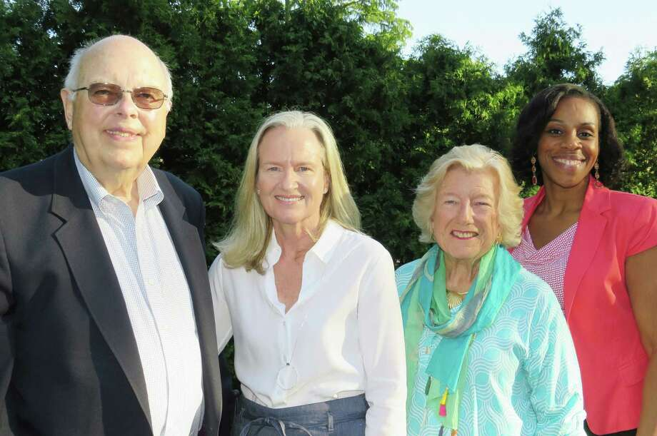 William Taggart, left, of New Canaan, Jan Smith, of Darien, Judy Kilmartin, of Darien, and Rebecca Wilson, of Stamford, were named one of the directors emeriti by the Person-to-Person Board. Photo: Contributed Photo