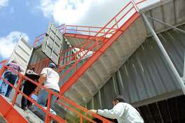 Crosby-Huffman Chamber of Commerce members and Safe Rescue representatives ascend the stairs of the Safe Rescue training tower structure in Crosby on Wednesday, July 26.
